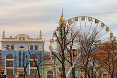 Beautiful landscape view of colorful ancient buildings on Kotraktova square Cotract square. Ferris wheel in historical part of city. Podil, Kyiv, Ukraine stock images