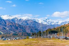 Beautiful landscape view of Hakuba in the winter with snow on the mountain and blue sky background in Nagano Japan. Beautiful landscape view of Hakuba in the stock photography
