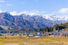 Beautiful landscape view of Hakuba in the winter with snow on the mountain and blue sky background in Nagano Prefecture Japan. Beautiful landscape view of royalty free stock photo