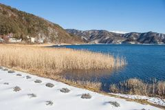 Beautiful landscape view of Kawaguchiko Lake with white snow in winter seasonal at Yamanashi. Beautiful landscape view of Kawaguchiko Lake with white snow in Stock Images