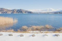 Beautiful landscape view of Kawaguchiko Lake with white snow in winter seasonal at Yamanashi. Beautiful landscape view of Kawaguchiko Lake with white snow in Stock Image