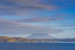 Beautiful landscape view of Lake Toya, Hokkaido, Japan. Presenting Mt. Yotei behind the cloud.