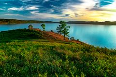Beautiful landscape view of the mountain lake Turgoyak Russia with summer house stock photography