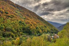 Ominous autumn colors. Beautiful landscape view of the mountains of the Rila national park in Bulgaria with vibrant autumn colors in the forest royalty free stock photography