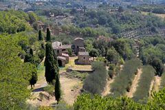 Beautiful landscape view with old buildings, trees and meadows,. Beautiful landscape view with old buildings, trees and meadows near Montepulciano town, Italy royalty free stock photography