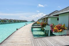 Beautiful landscape view of over water bungalows. At resort at Maldives Royalty Free Stock Photo