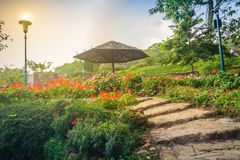 Beautiful landscape view with red flowering on the stone stairwa Royalty Free Stock Photos