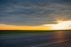 Beautiful landscape view of the road at dusk. Beautiful landscape view of the road at dusk Stock Image