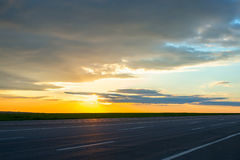 Beautiful landscape view of the road at dusk. Royalty Free Stock Photo