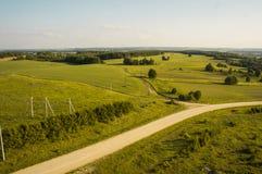 Road in green field. Beautiful landscape view of road in green field Stock Photos