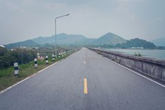 Beautiful landscape view of road way along side with reservoir at countryside. royalty free stock photos