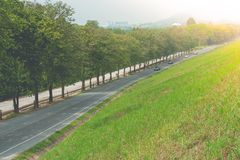 Beautiful landscape view of road way along side with reservoir at countryside. royalty free stock images