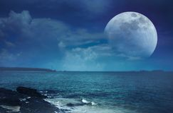 Landscape of sky with super moon on seascape. Serenity nature. Beautiful landscape view of the sea. Colorful blue sky with clouds and super moon on seascape in stock images