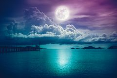 Landscape of sky with full moon on seascape to night. Serenity n Stock Image