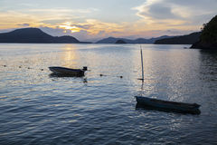Beautiful landscape view of sea at twilight time with the small. Boat in the sea Royalty Free Stock Photography