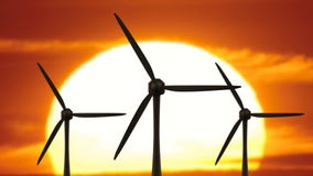 Beautiful landscape view of sunset wind turbine field. Windmills. apocalypse now stock footage
