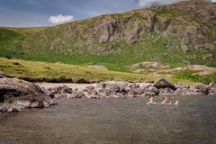 Beautiful landscape view of Wast Water in the Lake District National Park in the UK. Two people relaxing and enjoying refreshing. Bath in cold water on a stock photography