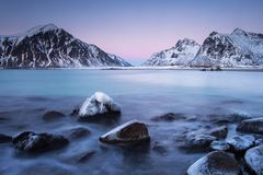 Beautiful landscape view with water in motion and mountain in background. Lofoten, Norway royalty free stock images