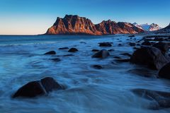Beautiful landscape view with water in motion and mountain in background. Lofoten, Norway stock photography