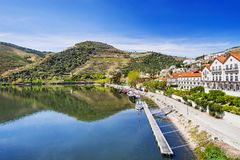 Landscape and vineyards in Douro valley with Pinhao village, Portugal. Beautiful landscape and vineyards in Douro valley with Pinhao village, Portugal royalty free stock photography