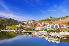 Landscape and vineyards in Douro valley with Pinhao village, Portugal. Beautiful landscape and vineyards in Douro valley with Pinhao village, Portugal stock photos