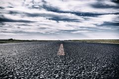 Beautiful landscape of vintage road, asphalt under blue sky. And clouds Stock Photos