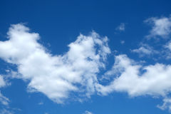 Beautiful landscape with white clouds on clear blue sky Stock Image