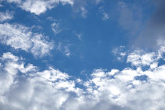 Beautiful landscape with white clouds on clear blue sky. Beautiful celestial landscape with white clouds high in the stratosphere on a sunny summer day Royalty Free Stock Images