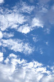 Beautiful landscape with white clouds on clear blue sky. Beautiful celestial landscape with white clouds high in the stratosphere on a sunny summer day Royalty Free Stock Photography
