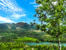 Beautiful landscape with wild forest and Periyar River, Kerala, India. THEKKADI, KERALA, INDIA - DEC. 15 2011: Beautiful landscape with colorful wild forest and Royalty Free Stock Photography