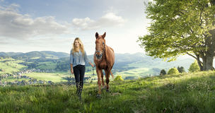 Beautiful landscape. With woman and horse Royalty Free Stock Images