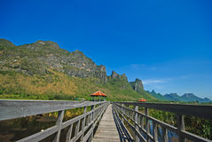 Beautiful landscape with wooden house and mountains, Bueng Bua at Sam Roi Yot National Park Royalty Free Stock Images