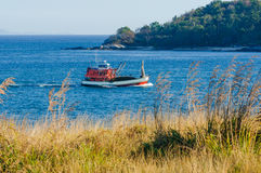 Beautiful Landscape with yellow grass and fishing boat. Composition of the nature Royalty Free Stock Images