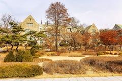 Beautiful landscaped autumn park. The territory of the University of Seoul. Horizontal stock photography
