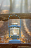 Beautiful lantern on wooden table in autumn forest Royalty Free Stock Images