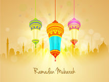 Beautiful lanterns and mosque for Ramadan Mubarak. Beautiful floral design decorated traditional hanging lanterns on mosque silhouetted shiny rays background
