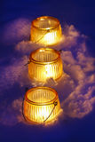 Beautiful lanterns on snow Stock Images