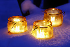 Beautiful lanterns on snow Royalty Free Stock Photos