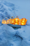 Beautiful lanterns on wooden tray. Snow around Stock Images