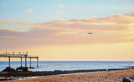 Landscape with airplain. Beautiful Lanzarote island landscape with airplain at sunset Royalty Free Stock Image