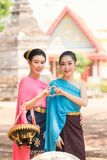 Beautiful Laos girls in traditional Lao traditional dress . Stock Image