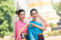 Beautiful Laos girls in traditional Lao traditional dress . Stock Photos
