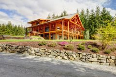 Beautiful large American classic log cabin home. Stock Photography