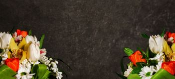 Bright bouquet of flowers on a gray marble background royalty free stock photos