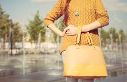 Beautiful large fashionable bag of the girl in her arms. Close up Stock Images