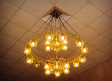 Beautiful large glowing yellow chandelier Royalty Free Stock Photo