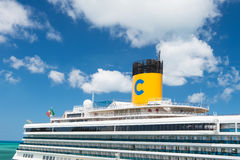 Beautiful large luxury cruise ship at moorage St. John, Antigua. St. John, Antigua - March 05, 2016: big white passenger boat, beautiful large cruise ship royalty free stock image