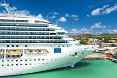 Beautiful large luxury cruise ship at moorage St. John, Antigua. St. John, Antigua - March 05, 2016: beautiful large cruise ship, big white passenger boat Stock Images