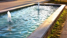 Beautiful large rectangular pool of a fountain stock images