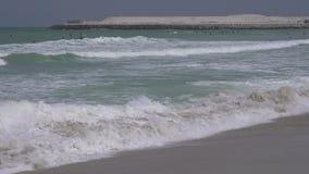 Beautiful large sea waves of Persian Gulf on the public Jumeirah Open Beach in Dubai stock footage video
